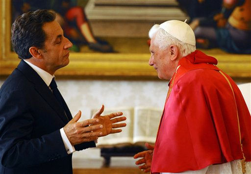 French President Nicolas Sarkozy talks to Pope Benedict XVI during a private audience at the Vatican, Friday, Oct. 8, 2010. French President Nicolas Sarkozy arrived for an audience Friday with Pope Benedict XVI that was largely seen as a fence-mending visit following France&#39;s controversial crackdown on Gypsies. Sarkozy&#39;s government has linked Gypsies, or Roma, to crime, dismantled hundreds of their shantytowns and expelled more than 1,000 Roma in recent months, sending them home to Romania and Bulgaria. The crackdown has been criticized by many Roman Catholics and Benedict himself appeared to weigh in on it with a subtle message about tolerance over the summer. &#40;AP Photo&#47;Christophe Simon, Pool&#41; <span class=meta>(AP Photo&#47; Christophe Simon)</span>