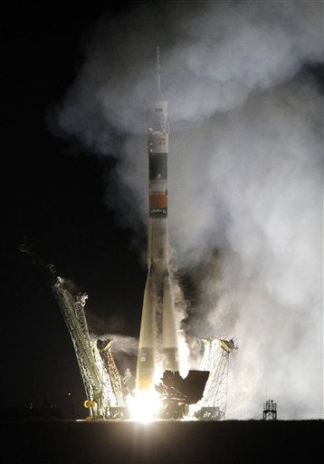 The Soyuz-FG rocket booster with Soyuz TMA-01M space ship carrying a new crew to the International Space Station, ISS, blasts off from the Russian leased Baikonur cosmodrome, Kazakhstan, early Friday, Oct. 8, 2010. The Russian rocket carries US astronaut Scott Kelly and two Russian cosmonauts Alexander Kaleri and Oleg Skripochka. &#40;AP Photo&#47;Dmitry Lovetsky&#41; <span class=meta>(AP Photo&#47; Dmitry Lovetsky)</span>