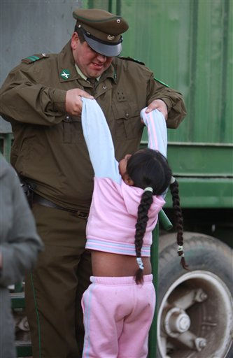 "<div class=""meta image-caption""><div class=""origin-logo origin-image ""><span></span></div><span class=""caption-text"">A young relative of a trapped miner plays with a police officer at the camp where families wait for news during the rescue effort outside the San Jose mine near Copiapo, Chile, Friday Oct. 8, 2010. Thirty-three miners have been trapped deep underground in the copper and gold mine since it collapsed on Aug. 5. (AP Photo/Natacha Pisarenko) (AP Photo/ Natacha Pisarenko)</span></div>"