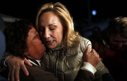Chile&#39;s First Lady Cecilia Morel, right, embraces a relative of a trapped miner outside the San Jose mine in Copiapo, Chile, Friday Oct. 8, 2010.  Drillers neared the lower reaches of a gold and copper mine where 33 men have been trapped for more than two months, preparing Friday for a breakthrough. The mine collapsed on Aug. 5. &#40;AP Photo&#47;Natacha Pisarenko&#41; <span class=meta>(AP Photo&#47; Natacha Pisarenko)</span>
