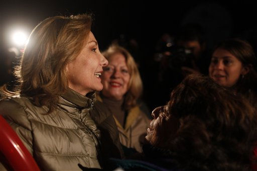 "<div class=""meta image-caption""><div class=""origin-logo origin-image ""><span></span></div><span class=""caption-text"">Chile's First Lady Cecilia Morel, left, visits the relatives of a trapped miners outside the San Jose mine in Copiapo, Chile, Friday Oct. 8, 2010.  Drillers neared the lower reaches of a gold and copper mine where 33 men have been trapped for more than two months, preparing Friday for a breakthrough. The mine collapsed on Aug. 5. (AP Photo/Natacha Pisarenko) (AP Photo/ Natacha Pisarenko)</span></div>"