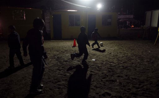 "<div class=""meta image-caption""><div class=""origin-logo origin-image ""><span></span></div><span class=""caption-text"">Children play soccer at the camp were relatives of a trapped miners wait for news of the rescue effort near the San Jose mine in Copiapo, Chile, Friday Oct. 8, 2010. Drillers neared the lower reaches of a gold and copper mine where 33 men have been trapped for more than two months, preparing Friday for a breakthrough. The mine collapsed on Aug. 5. (AP Photo/Natacha Pisarenko) (AP Photo/ Natacha Pisarenko)</span></div>"