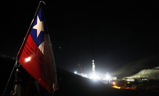 A Chilean flag hangs in front the site where drilling machines work to rescue 33 trapped miners from the collapsed San Jose mine in Copiapo, Chile, Friday Oct. 8, 2010. Drillers neared the lower reaches of a gold and copper mine where 33 men have been trapped for more than two months, preparing Friday for a breakthrough. The mine collapsed on Aug. 5. &#40;AP Photo&#47;Natacha Pisarenko&#41; <span class=meta>(AP Photo&#47; Natacha Pisarenko)</span>