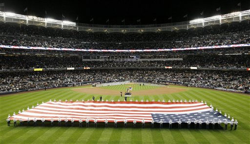 Cadets from the United States Military Academy at West Point unfurl an American flag before Game 3 of the American League Division Series baseball game between the New York Yankees and Minnesota Twins at Yankee Stadium on Saturday, Oct. 9, 2010 in New York.  &#40;AP Photo&#47;Peter Morgan&#41; <span class=meta>(AP Photo&#47; Peter Morgan)</span>