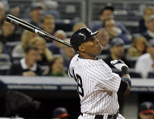 New York Yankees&#39; Marcus Thames  watches his fifth-inning, two-run home run off Minnesota Twins Brian Duensing in Game 3 of their American League Championship Series baseball game at Yankee Stadium on Saturday, Oct. 9, 2010 in New York. &#40;AP Photo&#47;Kathy Willens&#41; <span class=meta>(AP Photo&#47; Kathy Willens)</span>