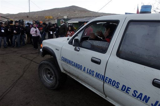 "<div class=""meta image-caption""><div class=""origin-logo origin-image ""><span></span></div><span class=""caption-text"">A man in a vehicle makes his way past the press at the entrance to the San Jose Mine near Copiapo, Chile Saturday, Oct. 9, 2010.  Sixty-six agonizing days after their gold and copper mine collapsed above them, 33 miners were offered a way out Saturday as a drill broke through to their underground purgatory. Word of the drill's success prompted cheers, tears and the ringing of bells by families in the tent camp outside the mine. Some who have kept a vigil since the Aug. 5 disaster ran up a hill where 33 Chilean flags were planted, chanting and shouting with joy as a siren rang throughout ""Camp Hope,"" confirming the breakthrough, Saturday.  (AP Photo/Dario Lopez-Mills) (AP Photo/ Dario Lopez-Mills)</span></div>"