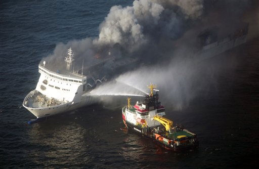 A firefighting vessel tries to extinguish a fire on the car ferry Lisco Gloria in the Baltic Sea, on Saturday, Oct. 9, 2010. The maritime emergencies center in Cuxhaven said that an explosion apparently occurred on the Lisco Gloria at about midnight. The Lithuanian-flagged ferry had more than 200 people on board and was traveling from the German port of Kiel to Klaipeda, Lithuania. German authorities said that all passengers and crew members have been rescued. &#40;AP Photo&#47;dapd, Axel Heimken&#41; <span class=meta>(AP Photo&#47; Axel Heimken)</span>