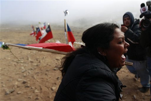 A woman reacts after it was announced that a drill reached the trapped miners at the San Jose Mine near Copiapo, Chile Saturday, Oct. 9, 2010.  Officials have announced that the drill trying to reach the 33 trapped miners has reached them after more than two months of efforts, prompting cheers, tears and the ringing of bells by families in the tent camp outside the mine.&#40;AP Photo&#47;Roberto Candia&#41; <span class=meta>(AP Photo&#47; Roberto Candia)</span>