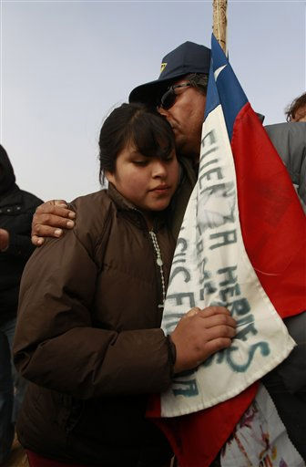 "<div class=""meta image-caption""><div class=""origin-logo origin-image ""><span></span></div><span class=""caption-text"">Relatives  embrace after it was announced that a drill reached the trapped miners at the San Jose Mine near Copiapo, Chile Saturday, Oct. 9, 2010. Officials have announced that the drill trying to reach the 33 trapped miners has reached them after more than two months of efforts, prompting cheers, tears and the ringing of bells by families in the tent camp outside the mine.(AP Photo/Roberto Candia) (AP Photo/ Roberto Candia)</span></div>"