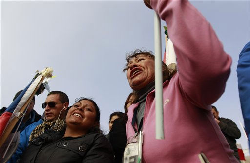 "<div class=""meta ""><span class=""caption-text "">Relatives celebrate after it was announced that a drill reached the trapped miners at the San Jose Mine near Copiapo, Chile, Saturday, Oct. 9, 2010. Officials have announced that the drill trying to reach the 33 trapped miners has reached them after more than two months of efforts, prompting cheers, tears and the ringing of bells by families in the tent camp outside the mine.(AP Photo/Roberto Candia) (AP Photo/ Roberto Candia)</span></div>"
