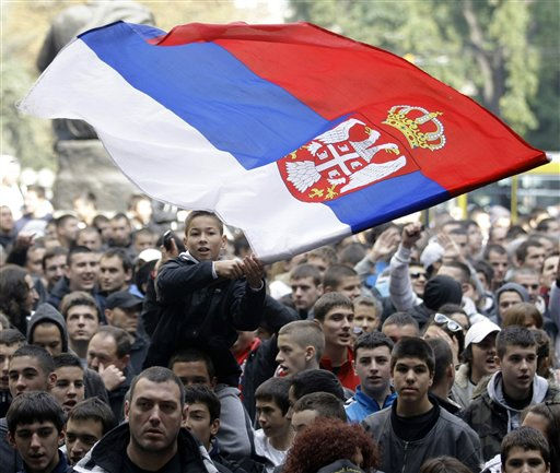 "<div class=""meta ""><span class=""caption-text "">A boy holds an Serbian flag during an anti-gay march organized in Belgrade, Serbia, Saturday, Oct. 9, 2010.  This weekend's staging a gay pride march is expected to be a major test for Serbia's democracy after extremists forced the cancellation of last year's event, international human rights organizations said. (AP Photo/Darko Vojinovic) (AP Photo/ Darko Vojinovic)</span></div>"