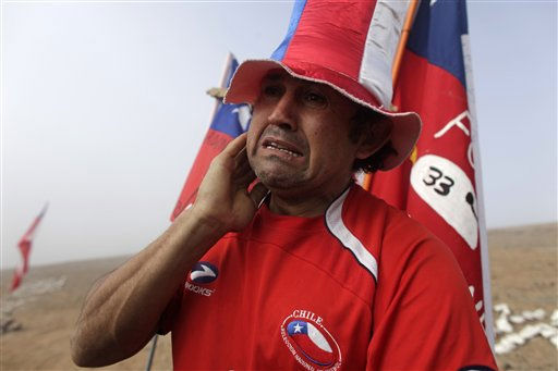 A man weeps after it was announced that a drill reached the trapped miners at the San Jose Mine near  Copiapo, Chile,  Saturday, Oct. 9,  2010.  Officials have announced that the drill trying to reach the 33 trapped miners has reached them after more than two months of efforts, prompting cheers, tears and the ringing of bells by families in the tent camp outside the mine.&#40;AP Photo&#47;Dario Lopez-Mills&#41; <span class=meta>(AP Photo&#47; Dario Lopez-Mills)</span>