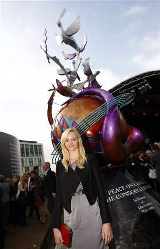 "<div class=""meta ""><span class=""caption-text "">US artist Lauren Voiers, who stands in front of her European peace monument dedicated to the memory of singer, songwriter John Lennon in Chavasse Park, Liverpool, England, Saturday Oct. 9, 2010. The unveiling of the eighteen foot peace monument entitled Peace and Harmony celebrates what would have been John Lennon's 70th birthday. (AP Photo/Tim Hales) (AP Photo/ Tim Hales)</span></div>"