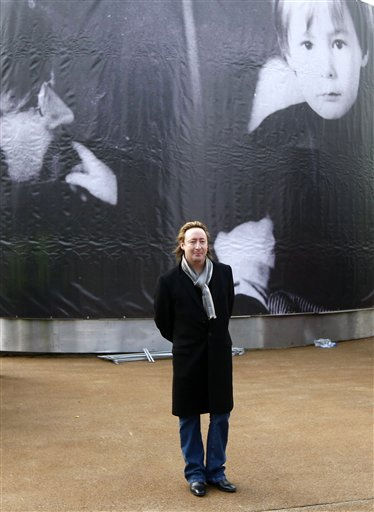 "<div class=""meta ""><span class=""caption-text "">Julian Lennon at the unveiling of a European peace monument dedicated to the memory of his father John Lennon in Chavasse Park, Liverpool, England, Saturday Oct. 9, 2010. The unveiling of the eighteen foot peace monument entitled Peace and Harmony celebrates what would have been John Lennon's 70th birthday. (AP Photo/Tim Hales) (AP Photo/ Tim Hales)</span></div>"