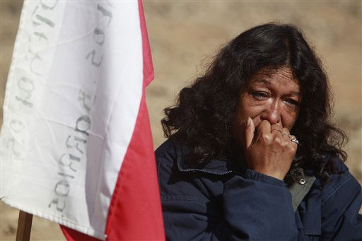 A relative reacts after it was announced that a drill reached the trapped miners at the San Jose Mine near Copiapo,  Chile,  Saturday, Oct. 9,  2010.  A drill reached the miners at a point 2,041 feet &#40;622 meters&#41; below the surface at 8:05 a.m., after 33 days of drilling. &#40;AP Photo&#47;Natacha Pisarenko&#41; <span class=meta>(AP Photo&#47; Natacha Pisarenko)</span>