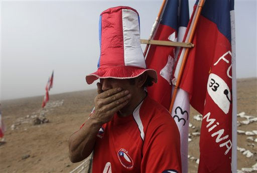 A man reacts after it was announced that a drill reached the trapped miners at the San Jose mine, near Copiapo, Chile,  Saturday, Oct. 9,  2010.  Officials have announced that the drill trying to reach the 33 trapped miners has reached them after more than two months of efforts, prompting cheers, tears and the ringing of bells by families in the tent camp outside the mine.&#40;AP Photo&#47;Dario Lopez-Mills&#41; <span class=meta>(AP Photo&#47; Dario Lopez-Mills)</span>