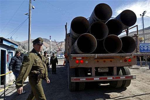 "<div class=""meta image-caption""><div class=""origin-logo origin-image ""><span></span></div><span class=""caption-text"">Police officers check a truck loaded with steel pipes at the entrance of the San Jose mine near Copiapo, Chile, Saturday, Oct. 9, 2010. A drilling rig punched through to the underground site where the 33 miners have been trapped for 66 days under the Chilean desert, raising cheers, tears and hopes. (AP Photo/Natacha Pisarenko) (AP Photo/ Natacha Pisarenko)</span></div>"