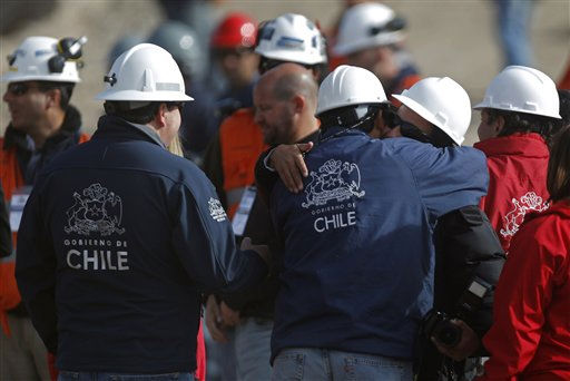 "<div class=""meta ""><span class=""caption-text "">People involved in the rescue efforts of trapped miners celebrate at the San Jose Mine near Copiapo, Chile, Saturday, Oct. 9, 2010. A drilling rig punched through to the underground site where the 33 miners have been trapped for 66 days under the Chilean desert, raising cheers, tears and hopes. (AP Photo/Natacha Pisarenko) (AP Photo/ Natacha Pisarenko)</span></div>"