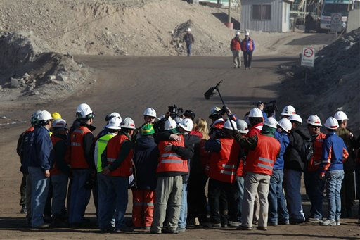 "<div class=""meta ""><span class=""caption-text "">Mining officials and personnel involved in the rescue operation of trapped miners celebrate at the San Jose Mine near Copiapo, Chile Saturday, Oct. 9, 2010. A drilling rig punched through to the underground site where the 33 miners have been trapped for 66 days under the Chilean desert, raising cheers, tears and hopes. (AP Photo/Dario Lopez-Mills) (AP Photo/ Dario Lopez-Mills)</span></div>"