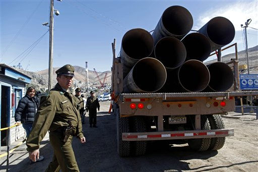 "<div class=""meta ""><span class=""caption-text "">A truck loaded with steel pipes that may be used on the rescue of the trapped miners enters the San Jose mine,  near Copiapo, Chile, Saturday, Oct. 9, 2010. Officials have announced that a drill has reached the 33 trapped miners  after more than two months of efforts, prompting cheers, tears and the ringing of bells by families in the tent camp outside the mine. (AP Photo/Natacha Pisarenko) (AP Photo/ Natacha Pisarenko)</span></div>"