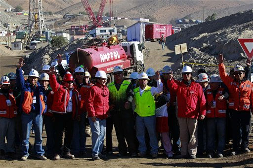 "<div class=""meta ""><span class=""caption-text "">Chilean mining officials and personnel involved in the rescue operation of 33 trapped miners wave as they celebrate at  the San Jose Mine near Copiapo, Chile Saturday, Oct. 9, 2010. A drilling rig punched through to the underground site where the 33 miners have been trapped for 66 days under the Chilean desert, raising cheers, tears and hopes. (AP Photo/Dario Lopez-Mills) (AP Photo/ Dario Lopez-Mills)</span></div>"