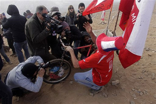 A group of journalists,  part of the hundreds of media members covering rescue efforts, surround a man as he reacts after it was announced that a drill reached the 33 trapped miners at the San Jose mine,  near Copiapo,  Chile,  Saturday, Oct. 9, 2010.&#40;AP Photo&#47;Dario Lopez-Mills&#41; <span class=meta>(AP Photo&#47; Dario Lopez-Mills)</span>