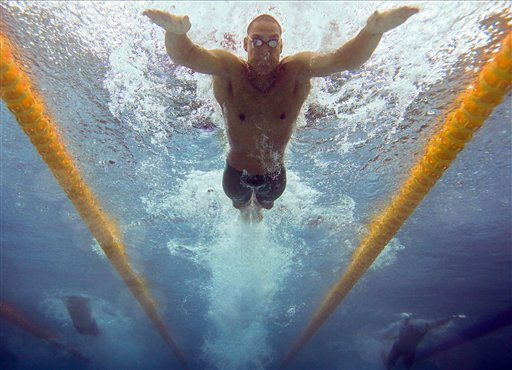 "<div class=""meta ""><span class=""caption-text "">Australia's Geoffrey Huegill swims the butterfly leg of the men's 4x100 medley relay final during the Commonwealth Games at the Dr. S.P. Mukherjee Aquatics Center in New Delhi, India, Saturday, Oct. 9, 2010. Australia won the gold medal. (AP Photo/Domenico Stinellis) (AP Photo/ Domenico Stinellis)</span></div>"