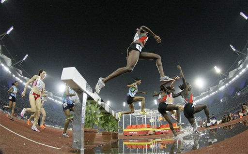In this photo taken with a fisheye lens, athletes compete in the Women&#39;s 3000m Steeplechase final during the Commonwealth Games at the Jawaharlal Nehru Stadium in New Delhi, India, Saturday, Oct. 9, 2010. &#40;AP Photo&#47;Lee Jin-man&#41; <span class=meta>(AP Photo&#47; Lee Jin-man)</span>
