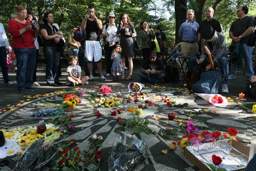 "<div class=""meta ""><span class=""caption-text "">People gather around the Imagine mosaic in Strawberry Fields in New York's Central Park, Saturday, Oct. 9, 2010. This would have been John Lennon's 70th birthday. (AP Photo/Tina Fineberg) (AP Photo/ Tina Fineberg)</span></div>"