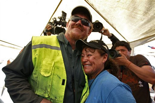 Jeff Hart, the T-130 drill operator from Denver, Colorado, embraces Elizabeth Segovia, sister of trapped miner Dario Segovia Rojo at  the San Jose mine near Copiapo, Chile Saturday, Oct. 9, 2010. A drilling rig punched through to the underground site where the 33 miners have been trapped for 66 days under the Chilean desert, raising cheers, tears and hopes. &#40;AP Photo&#47;Roberto Candia&#41; <span class=meta>(AP Photo&#47; Roberto Candia)</span>