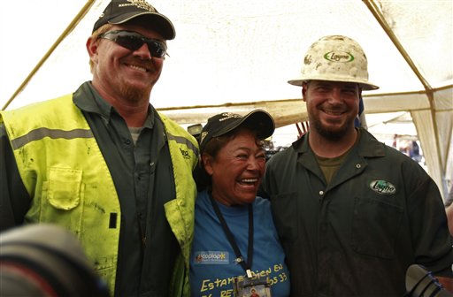 The T-130 drill operators, Jeff Hart, left, and Matt Staffel, right, both from Denver, Colorado, embrace Elizabeth Segovia, sister of trapped miner Dario Segovia Rojo at  the San Jose mine near Copiapo, Chile Saturday, Oct. 9, 2010. A drilling rig punched through to the underground site where the 33 miners have been trapped for 66 days under the Chilean desert, raising cheers, tears and hopes. &#40;AP Photo&#47;Roberto Candia&#41; <span class=meta>(AP Photo&#47; Roberto Candia)</span>
