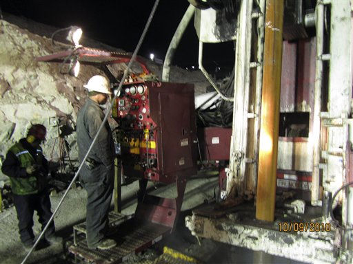 "<div class=""meta ""><span class=""caption-text "">Matt Staffel, top left, operates the T-130 drill during the final push to reach the 33 trapped miners at the San Jose mine near Copiapo, Chile Saturday Oct. 9, 2010. The drill rig punched through to the underground site  where 33 miners have been trapped for 66 days under the Chilean desert, raising cheers, tears and hopes. (AP Photo) (AP Photo/ STR)</span></div>"