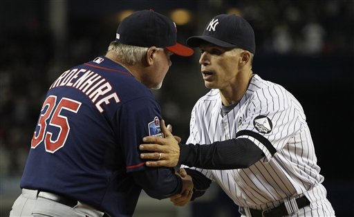 New York Yankees manager Joe Girardi, right, greets Minnesota Twins manager Ron Gardenhire &#40;35&#41;, left, at the start of Game 3 of their American League Championship Series baseball game at Yankee Stadium on Saturday, Oct. 9, 2010 in New York. &#40;AP Photo&#47;Kathy Willens&#41; <span class=meta>(AP Photo&#47; Kathy Willens)</span>