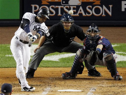 New York Yankees Robinson Cano hits a triple against the Minnesota Twins  in the second inning in Game 3 of the American League Division Series baseball game at Yankee Stadium on Saturday, Oct. 9, 2010 in New York.  Minnesota Twins catcher is Joe Mauer. &#40;AP Photo&#47;Peter Morgan&#41; <span class=meta>(AP Photo&#47; Peter Morgan)</span>