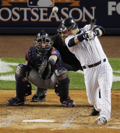 New York Yankees Nick Swisher hits a double in the third inning in Game 3 of the American League Division Series baseball game at Yankee Stadium on Saturday, Oct. 9, 2010 in New York.  Minnesota Twins catcher is Joe Mauer. &#40;AP Photo&#47;Peter Morgan&#41; <span class=meta>(AP Photo&#47; Peter Morgan)</span>