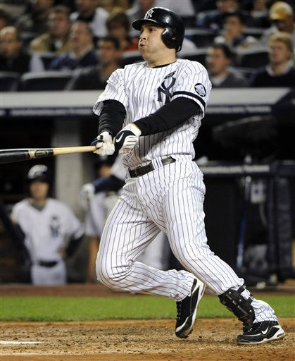 New York Yankees&#39; Mark Teixeira follows through on a RBI single driving in Nick Swisher during the third inning in Game 3 of the American League Division Series baseball game against the Minnesota Twins Saturday, Oct. 9, 2010 at Yankee Stadium in New York. &#40;AP Photo&#47; Bill Kostroun&#41; <span class=meta>(AP Photo&#47; Bill Kostroun)</span>