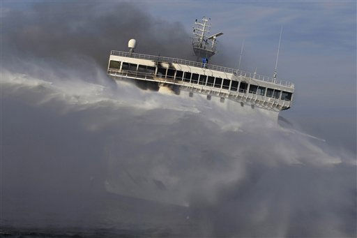 The empty 650-foot ferry Lisco Gloria is being cooled by a deluge of water sprayed onto its decks, as it stands in the Baltic Sea on Sunday, Oct. 10, 2010, near the island of Langeland in Denmark, after an explosion on its upper deck engulfed the vessel and forced the evacuation of almost 250 people aboard. Germany maritime officials said Sunday the fire on the Lisco Gloria ferry was still burning in the ferry&#39;s stern, but it appears to be slowly fading away. &#40;AP Photo&#47;dapd, Philipp Guelland&#41; <span class=meta>(AP Photo&#47; Philipp Guelland)</span>