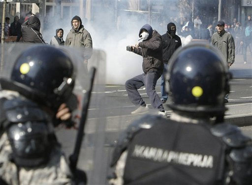 Protesters throw stones at the members of the riot police during an anti gay pride march in Belgrade, Serbia, Sunday, Oct. 10, 2010. Riot police in Serbia clashed with some hundreds of far-right supporters who tried to disrupt a gay pride march in Belgrade on Sunday, with more than a dozen people reported injured, officials said. &#40;AP Photo&#47;Darko Vojinovic&#41; <span class=meta>(AP Photo&#47; Darko Vojinovic)</span>