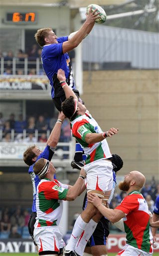 Bath&#39;s Stuart Hooper, top, wins the line out from Biarritz Olympique&#39;s Manuel Carizza, during their Heineken Cup round one rugby match at the Recreation ground, Bath, Britain, Sunday, Oct. 10, 2010. &#40;AP Photo&#47;Tom Hevezi&#41; <span class=meta>(AP Photo&#47; Tom Hevezi)</span>