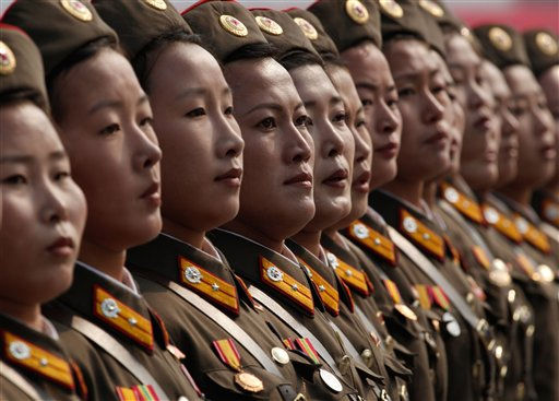 "<div class=""meta image-caption""><div class=""origin-logo origin-image ""><span></span></div><span class=""caption-text"">North Korean women soldiers march a massive military parade marking the 65th anniversary of the communist nation's ruling Workers' Party in Pyongyang, North Korea on Sunday, Oct. 10, 2010. This year's celebration comes less than two weeks after Kim Jong Il's re-election to the party's top post and the news that his 20-something son would succeed his father and grandfather as leader. (AP Photo/Vincent Yu) (AP Photo/ Vincent Yu)</span></div>"