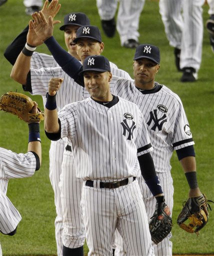 New York Yankees Derek Jeter, Robinson Cano, Alex Rodriguez, and Mark Teixeira celebrate after beating the Minnesota Twins 6-1 to win the American League Division Series at Yankee Stadium on Saturday, Oct. 9, 2010 in New York.  &#40;AP Photo&#47;Peter Morgan&#41; <span class=meta>(AP Photo&#47; Peter Morgan)</span>