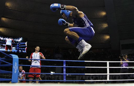 Anthony Ogogo of England jumps up and down as he jeers the crowd after winning against India&#39;s Vijender Singh in the men&#39;s 75kg category semifinals during the Commonwealth Games at the Talkatora Indoor Stadium in New Delhi, India, Monday, Oct. 11, 2010. Vijender, who was leading 3-0, was twice penalized for clinging leading to England&#39;s controversial win by 4-3. &#40;AP Photo&#47;Saurabh Das&#41; <span class=meta>(AP Photo&#47; Saurabh Das)</span>