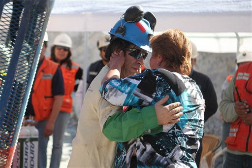**  CORRECTS SPELLING OF MINER&#39;S NAME TO JOHNNY  **  In this photo released by the Government of Chile, miner Johnny Barrios Rojas, left, embraces his girlfriend Susana Valenzuela after being rescued from the collapsed San Jose gold and copper mine, near Copiapo, Chile, Wednesday, Oct. 13, 2010. Barrios was the twenty first of 33 miners to be rescued from the mine after more than 2 months trapped underground.&#40;AP Photo&#47;Hugo Infante, Government of Chile&#41;. <span class=meta>(AP Photo&#47; Hugo Infante)</span>