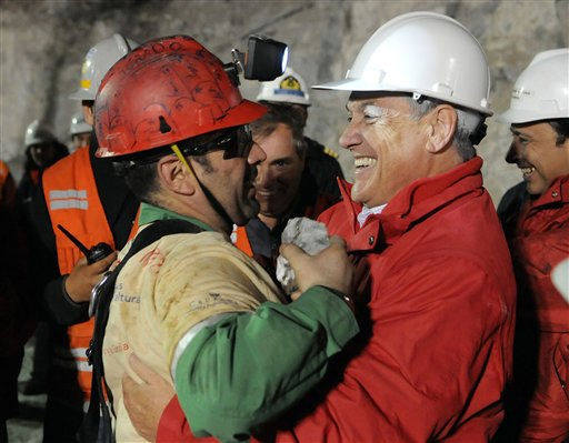 In this photo released by the Chilean presidential press office, Chile&#39;s President Sebastian Pinera, right, hugs rescued miner Mario Sepulveda after Sepulveda was rescued from the collapsed San Jose gold and copper mine where he was trapped with 32 other miners for over two months near Copiapo, Chile, early Wednesday, Oct. 13, 2010.  &#40;AP Photo&#47;Jose Manuel de la Maza, Chilean Presidential Press Office&#41; <span class=meta>(AP Photo&#47; Jose Manuel de la Maza)</span>