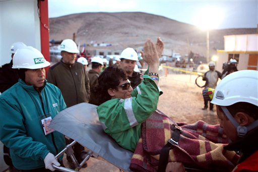 "<div class=""meta ""><span class=""caption-text "">In this photo released by the Chilean government, miner Claudio Yanez applauds as he is carried away in a stretcher after being rescued from the collapsed San Jose gold and copper mine where he had been trapped with 32 other miners for over two months near Copiapo, Chile, early Wednesday Oct. 13, 2010.  (AP Photo/Hugo Infante, Chilean government) (AP Photo/ Hugo Infante)</span></div>"