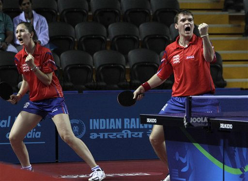 England&#39;s Joanna Parker, left, and Paul Drink Hall reacts after winning a point in their table tennis mixed double match against Australia&#39;s Willam Henzell and Miap Miao during the Commonwealth Games at the Yamuna Sports Complex in New Delhi, India, Tuesday, Oct. 12, 2010. England won the Bronze medal.&#40;AP Photo&#47;Manish Swarup&#41; <span class=meta>(AP Photo&#47; Manish Swarup)</span>