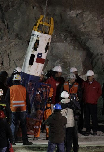 ** CORRECTS FIRST NAME OF PRESIDENT TO SEBASTIAN ** Chile&#39;s President Sebastian Pinera, right, looks on as rescue worker Manuel Gonzalez Paves enters the capsule prior to being lowered into the mine where miners are trapped to begin the rescue at the San Jose Mine near Copiapo, Chile, Tuesday, Oct. 12, 2010. The first of 33 trapped miners is expected to be lifted to the surface late Tuesday after surviving more than two months below ground.  &#40;AP Photo&#47;Jorge Saenz&#41; <span class=meta>(AP Photo&#47; Jorge Saenz)</span>