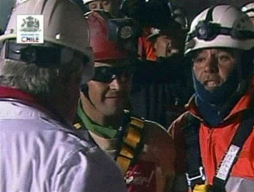 In this screen grab taken from video, Florencio Avalos, the first miner to be rescued, center, is greeted after his rescue Tuesday, Oct. 12, 2010 at San Jose Mine near Copiapo, Chile. &#40;AP Photo&#41; <span class=meta>(AP Photo&#47; DG**NY**)</span>