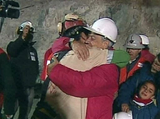 In this screen grab taken from video, Florencio Avalos, the first miner to be rescued, left, is embraced by Chilean President Sebastian Pinera after his rescue Tuesday, Oct. 12, 2010 at San Jose Mine near Copiapo, Chile. &#40;AP Photo&#41; <span class=meta>(AP Photo&#47; DG**NY**)</span>