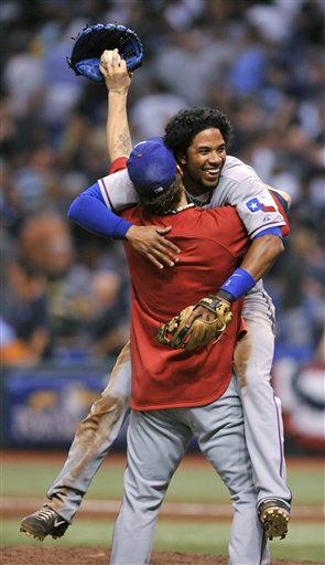 Texas Rangers&#39; Elvis Andrus is carried after the Rangers&#39; 5-1 win over the Tampa Bay Rays in Game 5 of baseball&#39;s American League Division Series, Tuesday, Oct. 12, 2010, in St. Petersburg, Fla. The Rangers advanced to the AL championship series against the New York Yankees. &#40;AP Photo&#47;Steve Nesius&#41; <span class=meta>(AP Photo&#47; Steve Nesius)</span>
